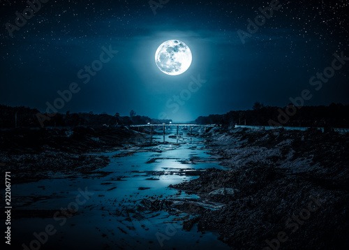 Landscape of night sky with many stars and bright full moon.