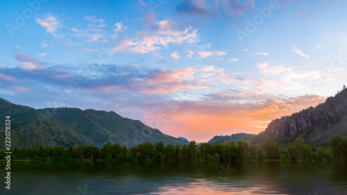 Panoramic view of the mountain river with island near ALtai, Russia. Mountain river stream landscape. Mountain wild river water view