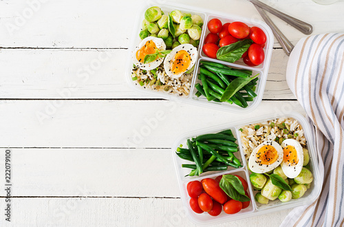 Foto op Canvas Kruidenierswinkel Vegetarian meal prep containers with eggs, brussel sprouts, green beans and tomato. Dinner in lunch box. Top view. Flat lay