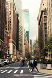 Fototapeta Nowy Jork - Broadway street in Manhattan's midtown by early evening,  New York City, United States. Toned image