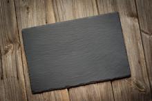 Slate Blackboard On Old Wooden...