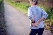People, Healthcare And Problem Concept - Unhappy Woman Suffering From Pain In Back Or Reins Outdoor