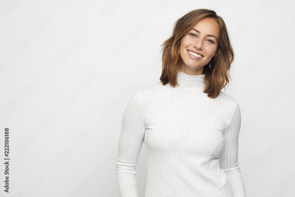 Fototapeta portrait of young smiling woman looks in camera