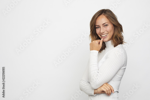 Portrait of young smiling woman looks in camera