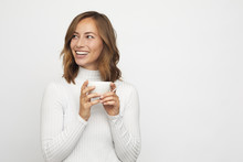 Young Woman With Cup Of Coffee Looks Left