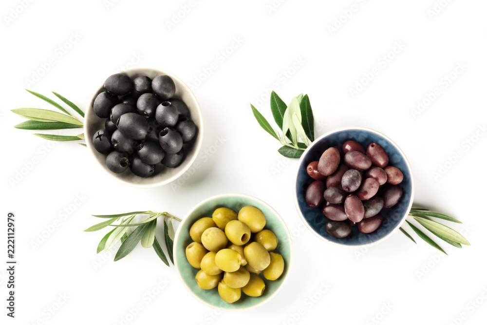 Fototapety, obrazy: Overhead photo of various olives in bowls on white with copy space