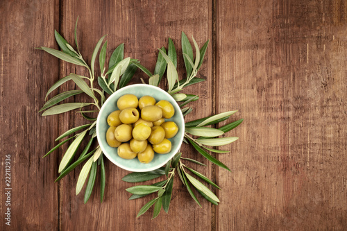 Overhead photo of olives in a bowl with copy space