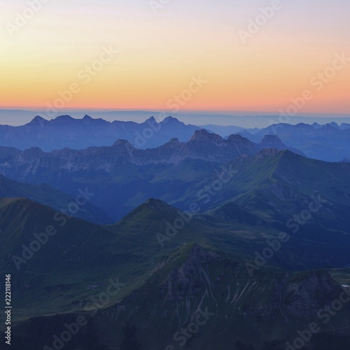 Mountain ranges in Vaud Canton at sunset. View from Glacier 3000, Switzerland.