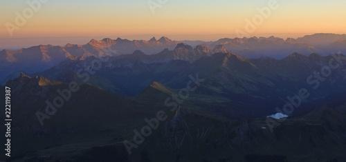 Foto op Aluminium Nachtblauw Stunning sunrise view from Glacier 3000, Switzerland. Mountain ranges and Lake Arnen.