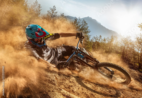 Mountain biker on forest trail Wallpaper Mural