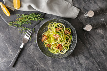 Plate With Zucchini Spaghetti And Mushrooms On Grey Table