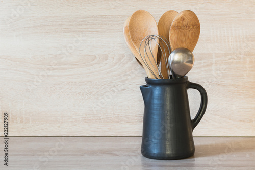Obraz na plátne Crockery, clayware, dark utensils and other different stuff on wooden tabletop