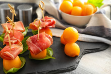 Delicious Melon Balls With Prosciutto On Slate Plate