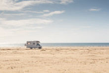 Campervan Parked On The Beach