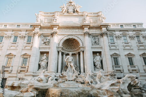 Tuinposter Rome The Trevi fountain in Rome, a beautiful sight. Ancient architecture and sculpture. Art on the street, the most beautiful fountain in Europe. Miracle of light