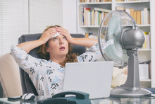 Woman Suffers From Heat In The Office Or At Home