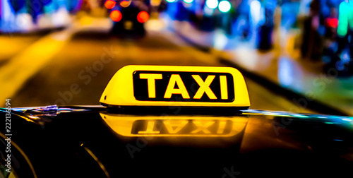 Fotografering Night picture of a taxi car