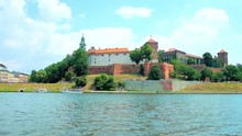 Enjoy The Picnic On The Bank Of Vistula River, Opening The View On Medieval Wawel Castle With Preserved Ramparts, High Towers And Lush Green Garden Around It, Krakow, Poland.