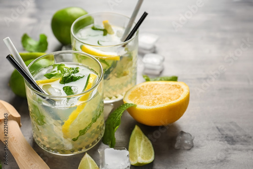 Glasses of fresh mojito on grey table
