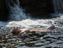 Beautiful Young Nude Woman Enjoying Summertime In Waterfall.