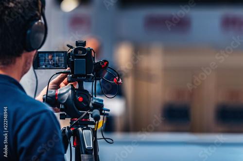 Cameraman Recording Event At Media Press Conference