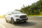 White suv sedan flying fast on the highway