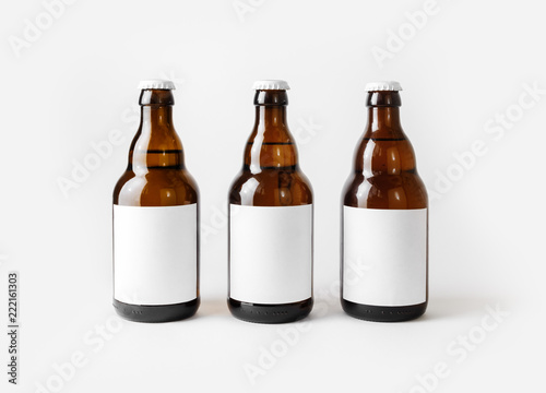 Three brown beer bottles with blank labels.