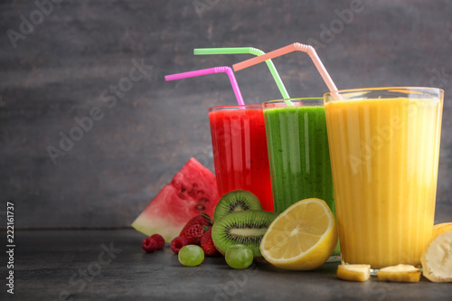 Recess Fitting Juice Glasses of tasty smoothies with fruits on grey table