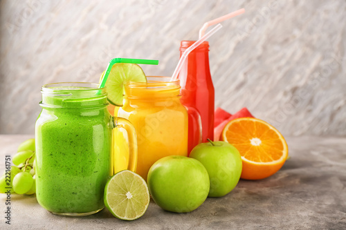 Recess Fitting Juice Glassware of tasty smoothies with fruits on grey table
