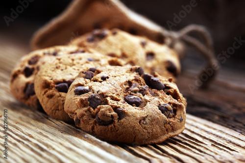 Keuken foto achterwand Koekjes Chocolate cookies on wooden table. Chocolate chip cookies shot.