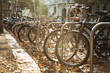 Many bicycles are parked in a row on Leipzig Street in Germany. Autumn. Ecological transport and a popular means of transportation in Europe.