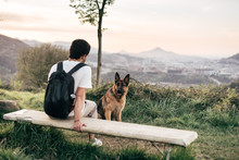 Man Playing With Dog In Nature