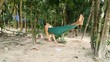 Young caucasian man relaxing on hammock in the middle of the tropical jungle during daytime