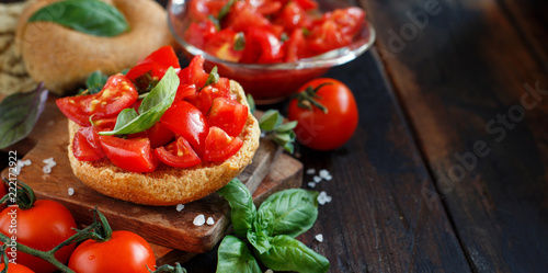 Fototapeta Frisella seasoned with tomatoes and herbs obraz