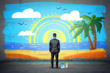 A Businessman Stands With His Back Turned And Looking At A Finished Wall Picture Of Exotic Isle.