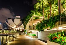 Beautiful Night View Of Wooden Walkway Along Marina Bay