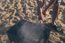 The Meat On The Grill.Delicious Festive Barbecue On The Sandy Beach In The Evening.The Food And The Concept Of Holliday.