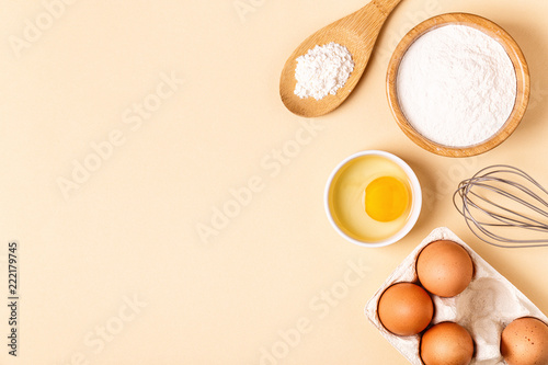 Canvas Prints Bread Ingredients and utensils for baking on a pastel background.