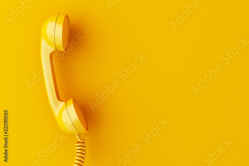 3d phone reciever on yellow background.