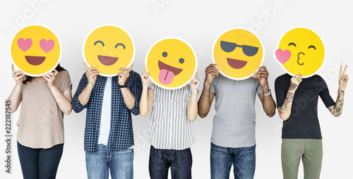 Diverse people holding happy emoticons Fotobehang