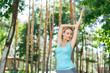 Peace of mind. Pleasant young woman standing in the special pose while practicing yoga outdoors