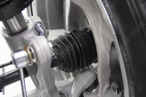 Valokuva  Automotive transmission parts - close up driveshaft, tripod CV-joint, shock adso