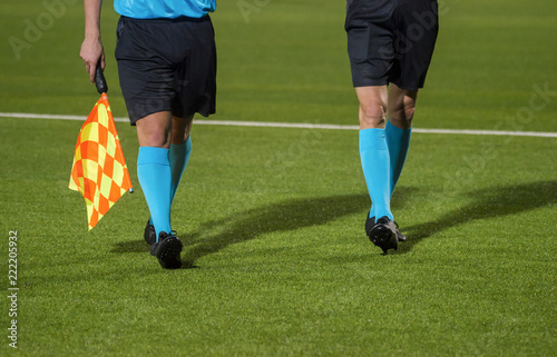 Assistant referee walking along the sideline during a soccer match Canvas Print