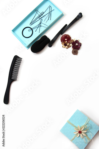 Smartphone Accessories and hair pins flat lay. Sponge for hair, hairdo babette. necklaces of beads or flowers, tiffany blue boxes made of cardboard. White background with copy space for text.