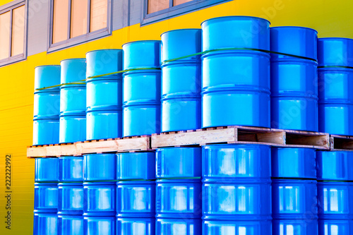 Photo Warehouse of metal barrels
