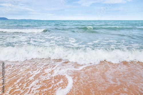Poster Water white soft wave rolling splash on empty tropical sandy beach in sunny day