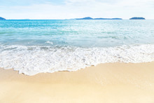 White Soft Wave Rolling Splash On Empty Tropical Sandy Beach In Sunny Day