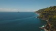 Aerial view sea coast, ocean, mountains, sea, beach, sky, clouds. Bali, Indonesia. Seascape with Seashore on the background of mountains Aerial footage