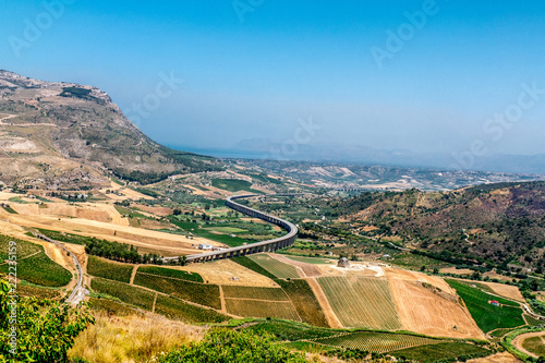 Fotografia, Obraz View of farmland, autostrada and Mediterranean Sea from Segesta, Sicily, Italy