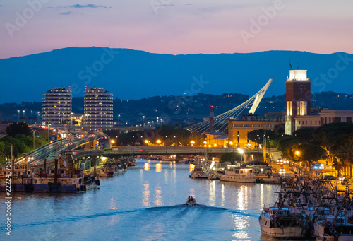 Photo Pescara (Italy) - The view in the dusk from Ponte del Mare monumental bridge in the canal and port of Pescara city, Abruzzo region